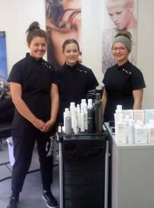 Three girls in salon uniforms