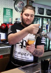Munro pulls a beer